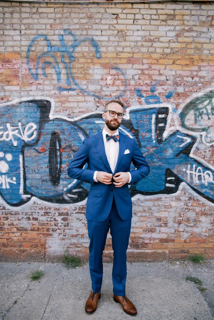 groom-with-graffiti-greenpoint-loft-wedding-683x1024.jpg