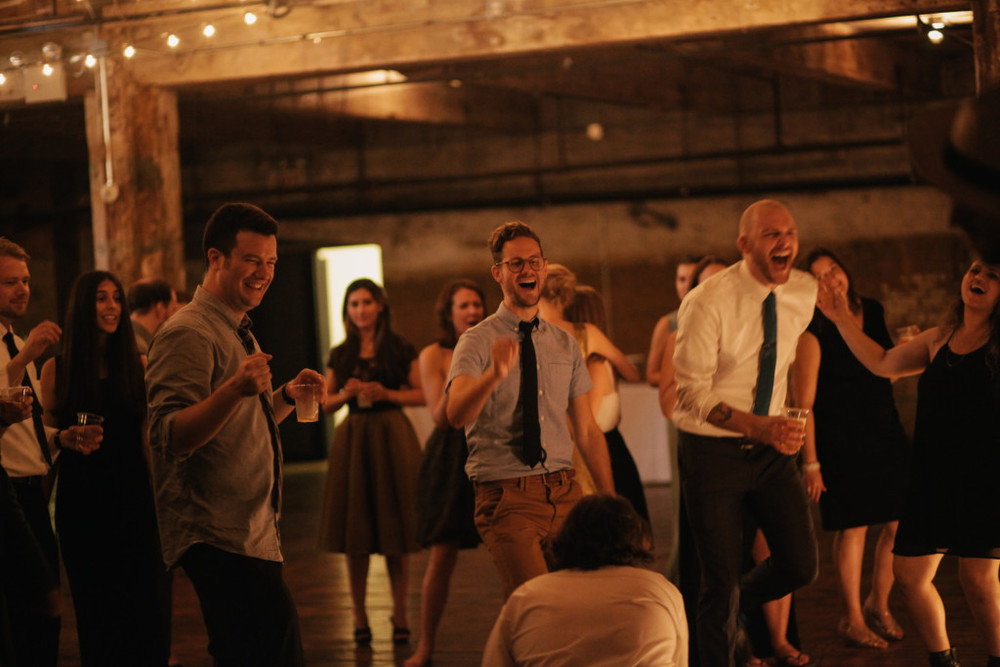singing-and-dancing-to-karaoke-greenpoint-loft-wedding-1024x683.jpg