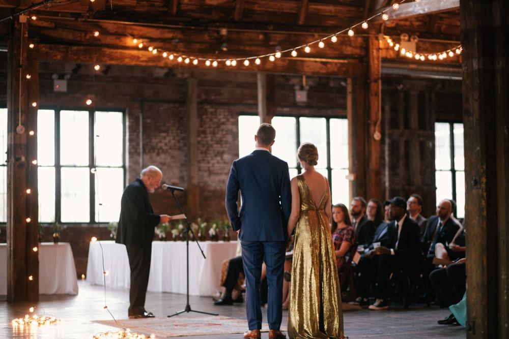 bride-and-groom-ceremony-greenpoint-loft-wedding-1024x683.jpg