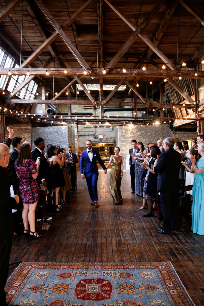 bride-and-groom-entrance-greenpoint-loft-wedding-683x1024.jpg