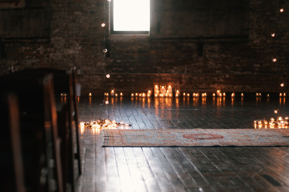 ceremony-surrounded-by-candles-greenpoint-loft-wedding-1024x683.jpg