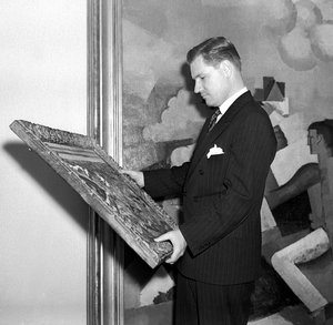 Nelson Rockefeller examining a painting at MoMA, 1950s