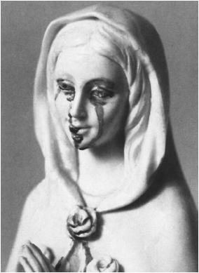 """A Virgin Mary statue weeping """"blood"""""""