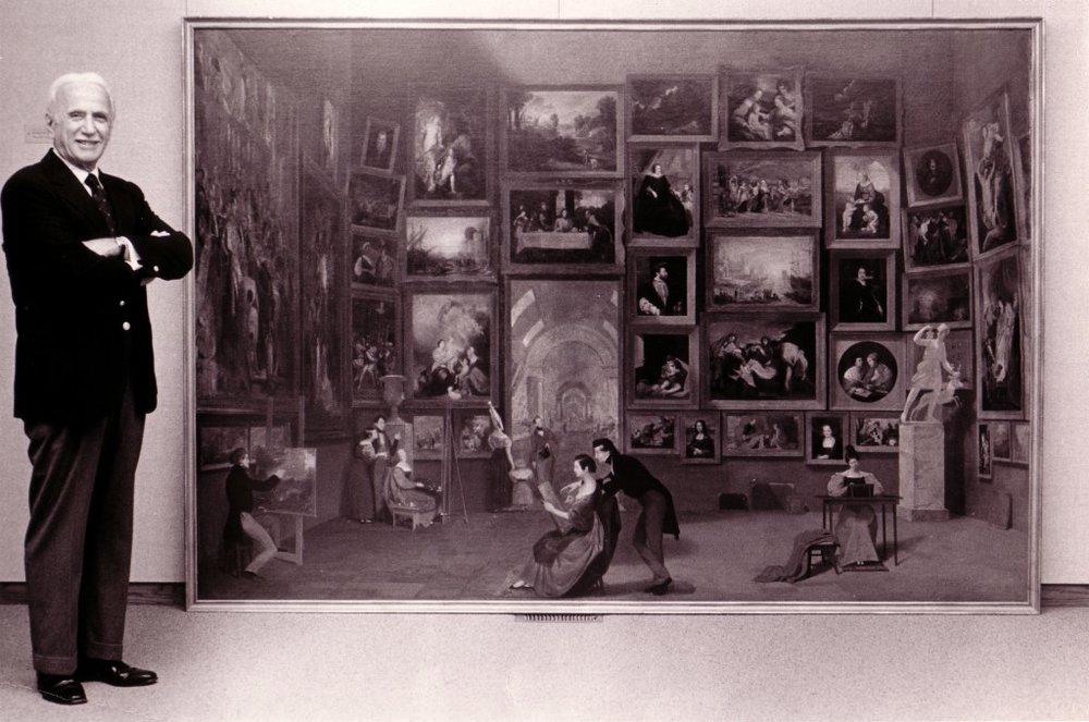 Daniel Terra, of the Terra Foundation, posing with The Gallery of the Louvre upon its purchase