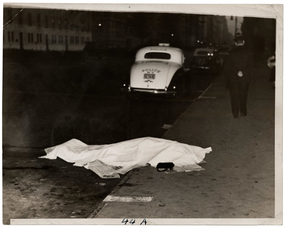 Weegee (Arthur Fellig), Girl jumped out of car, and was killed, on Park Ave., circa 1938