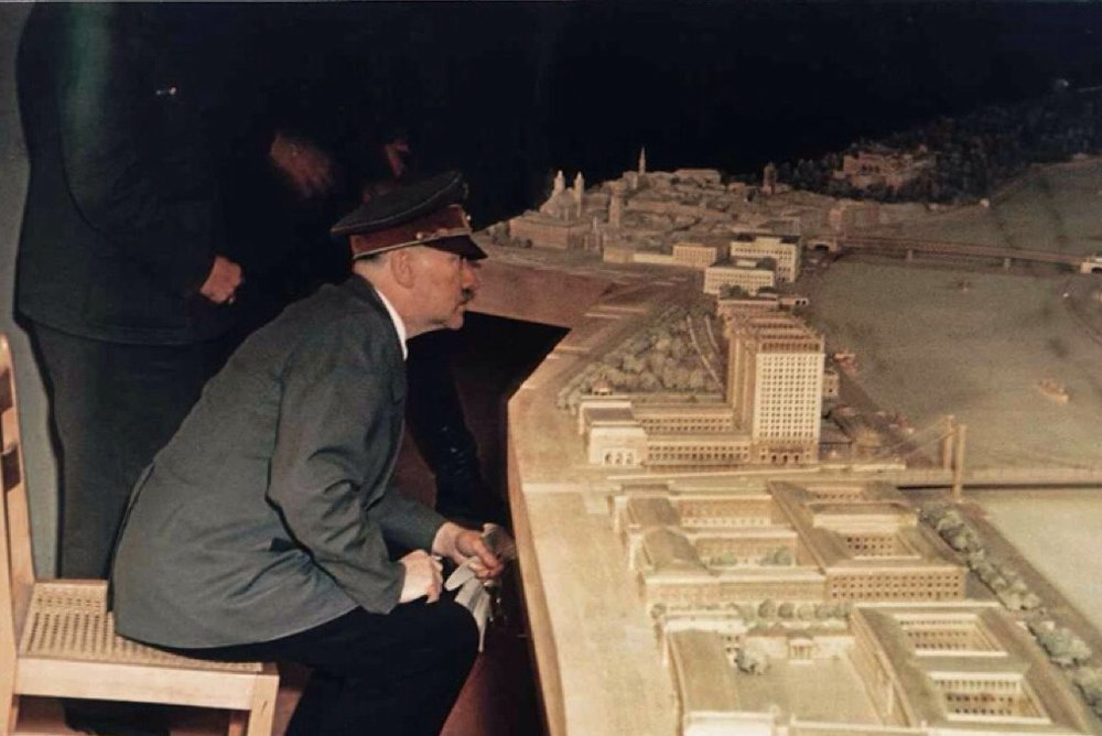 A rare color image of Hitler viewing the Linz model