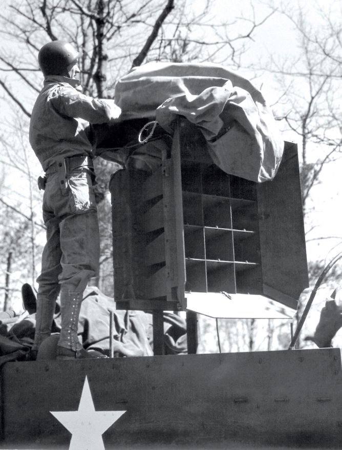 Ghost Army soldier setting up a speaker system for