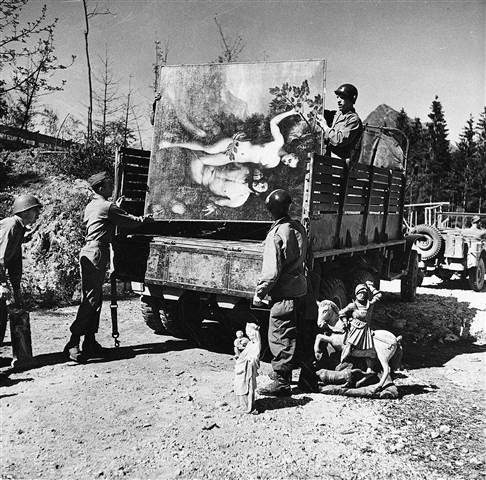 Unidentified military personnel unload some of the art treasures recovered from Hermann Goering's cave in the mountain side at Konigsee in May 1945.  Keystone Pool via AP file