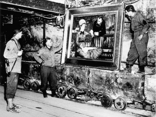 Soldiers pose with a looted painting by Manet discovered in a mine by men of the U.S. Army's 90th Division April 7, 1945. COURTESY JOHN PROVAN