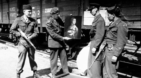 "Everett Parker Lesley, Jr. (left) returning Leonardo da Vinci's ""Lady with an Ermine"" to its home in Cracow, Poland in 1946.  Courtesy of the Monuments Men Foundation"