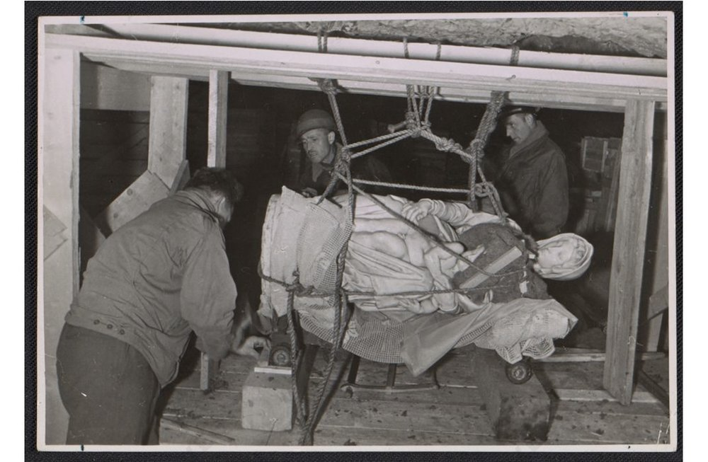 Stephen Kovalyak, George Stout and Thomas Carr Howe transporting Michelangelo's sculpture Madonna and child, July 9, 1945
