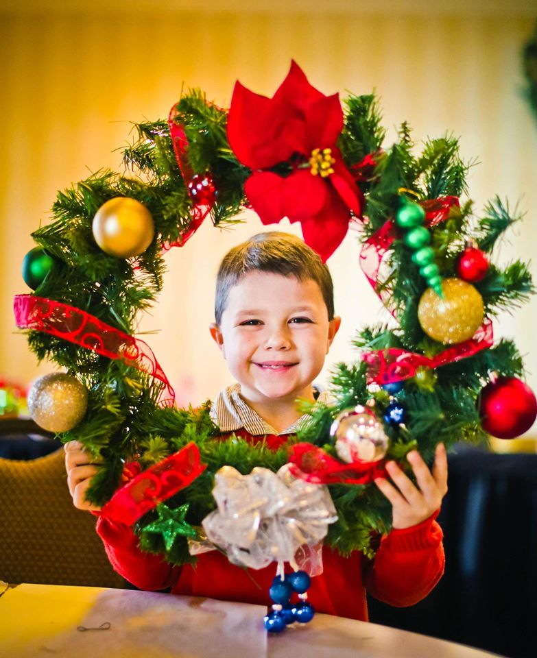Jack enjoying a special wreath making activity during his trip!