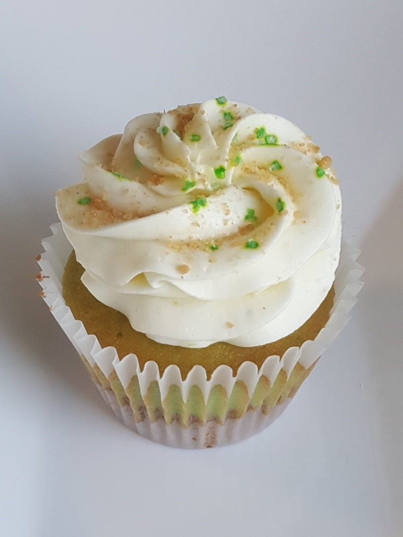 Key Lime Cupcake with Graham Cracker Bottom, Key Lime Curd Filling, Key Lime Cream Cheese Buttercream and Graham Cracker Crumbs!