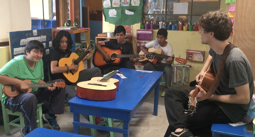 Teaching group guitar and Ukulele lessons to the 7th graders  at Robert Muller Life School, Guatemala
