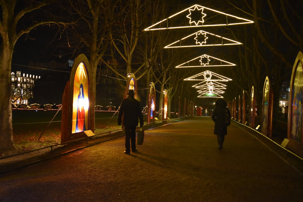 Nativity scenes illuminate the walkway at the Christmas Market in Baden Baden, Germany.