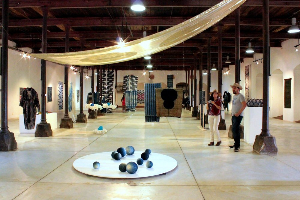 View of one end of the exhibit, all in shades of indigo