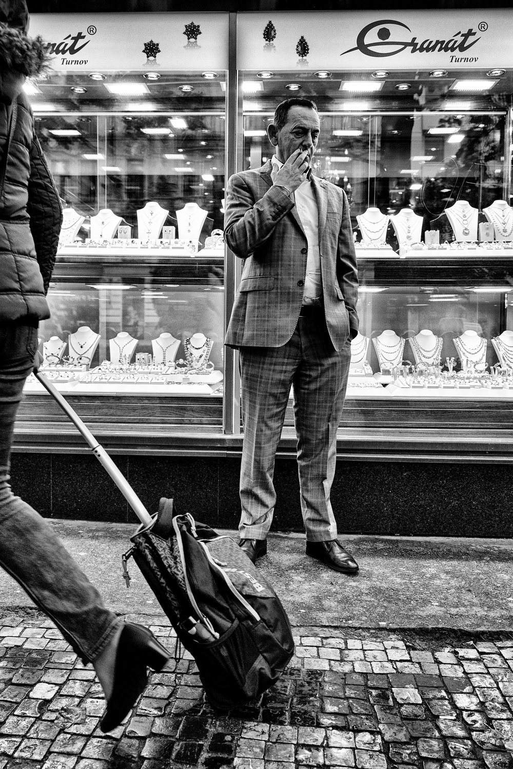 Contemplation. Prague, October 2016.  A snatched opportunity at twilight in Wenceslas Square, saw him but thought I'd missed the opportunity. Love that classic look. And set against the backdrop of the jewellers...