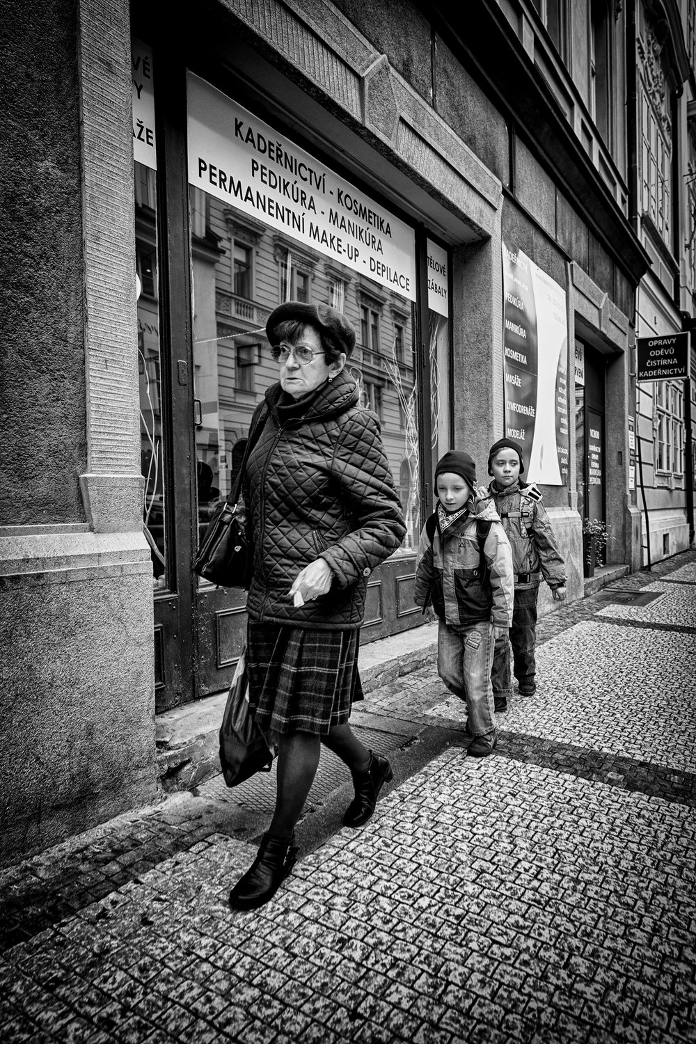Grandmother's Footsteps. Prague, October 2016.  These two seemed to be following their grandmother very carefully and almost discretely - just like the children's playground game.