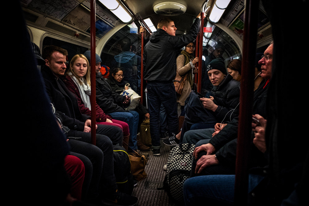 All in this together - humanity; London Underground, England. February 2017.