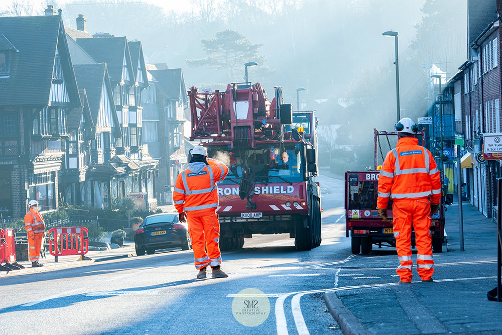 The arrival of the 60 tonne mobile crane on Oxted's Station Road East.