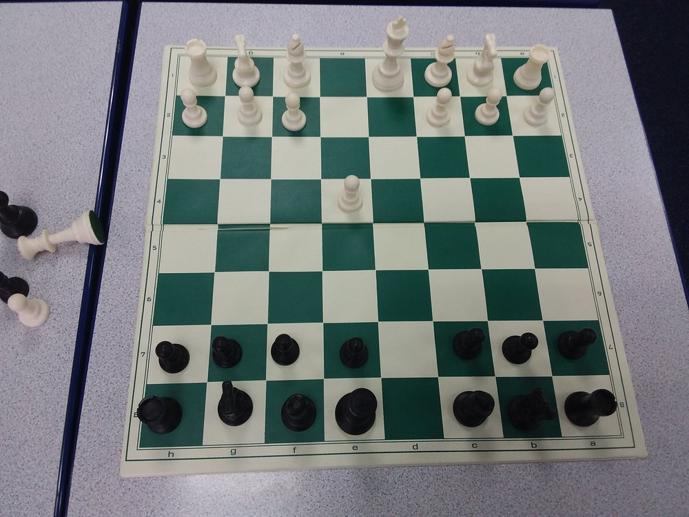 The position after the pawns and then the queens have swapped off. White can no longer castle.