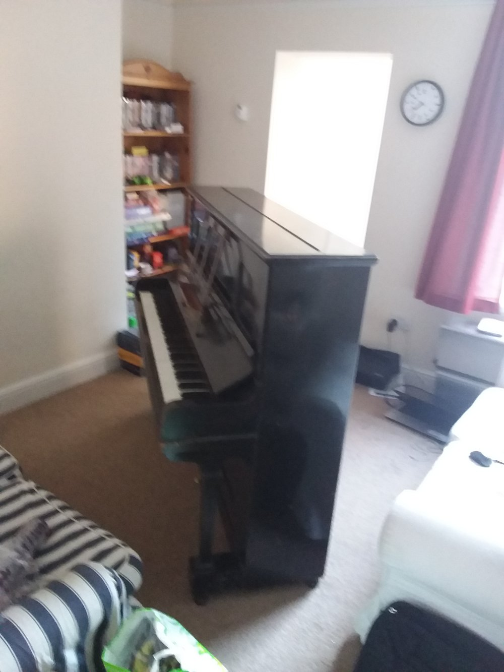 I spent about two days with the displaced piano rather dominating my sitting room.