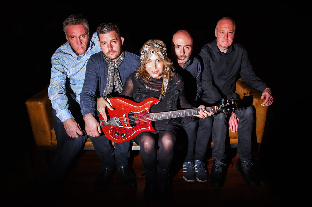 Brix with her current group, Brix & The Extricated, featuring ex-Fall member Steve Hanley (far right).