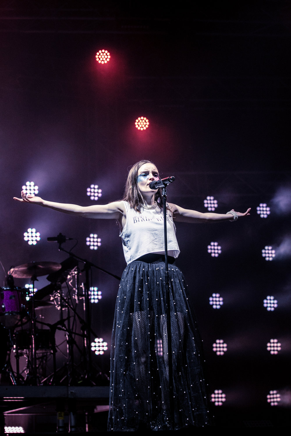 Chvrches' Lauren Mayberry makes the sign of the cross, Friday 13 July.  Credit: Hugo Macedo