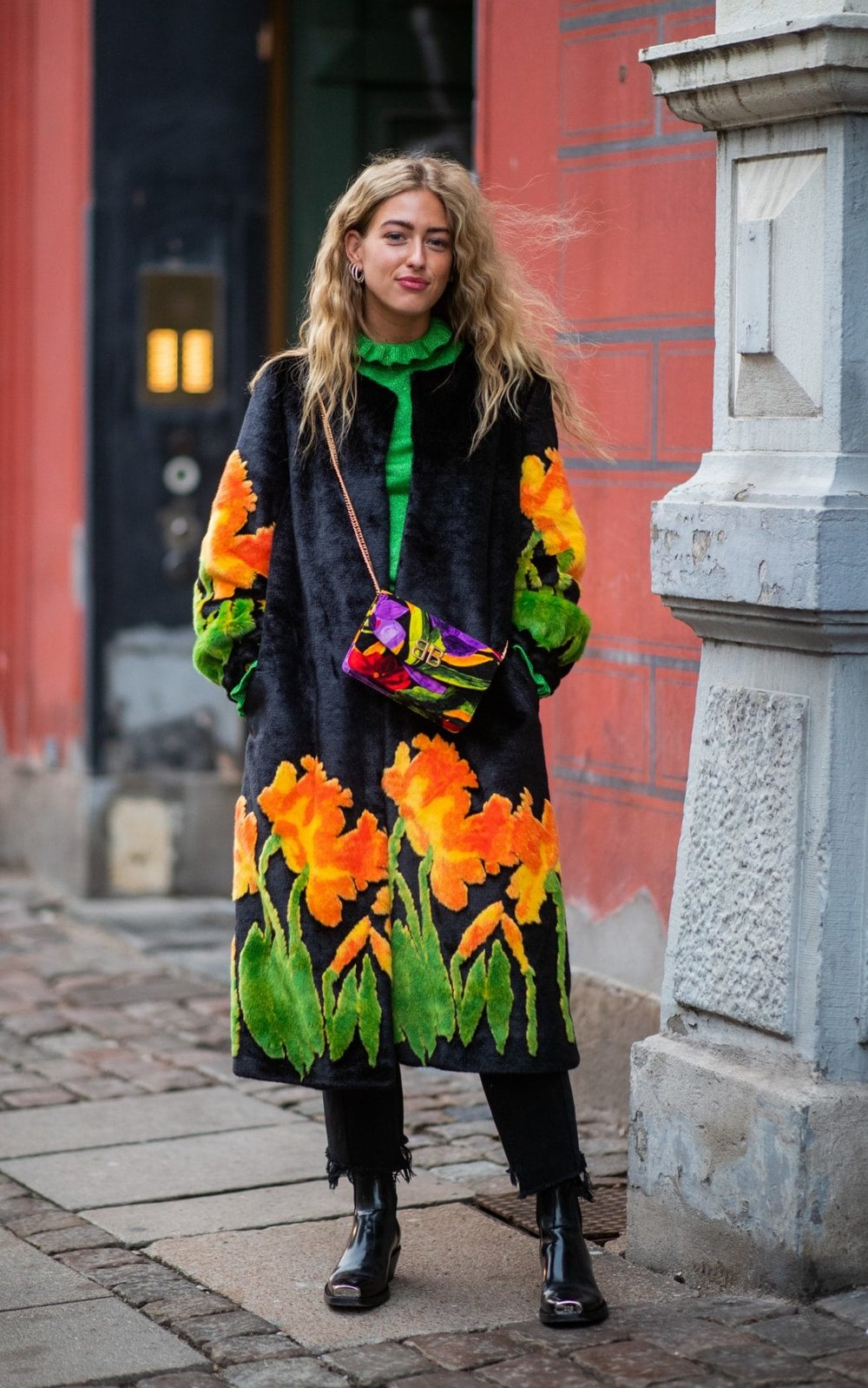 Emili Sindlev looks great in this statement coat, great choice for when your outwear needs to do the talking. Paired perfectly with the contrast bag and patent boots.