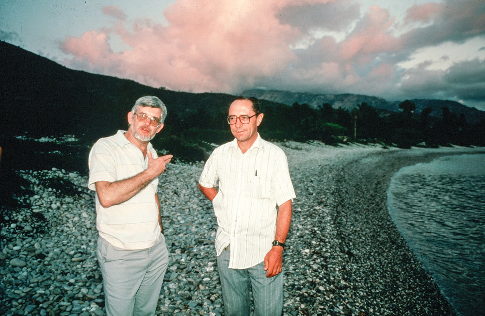 Dick and Father LaBourne on the beach in Haiti.