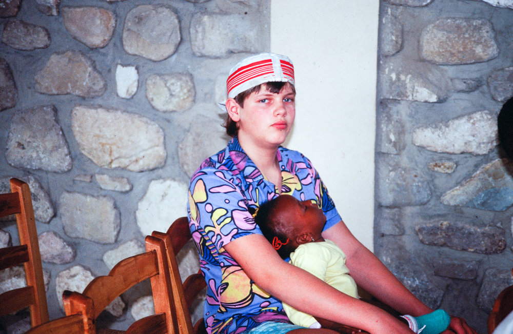 Martin with a young Haitian child.