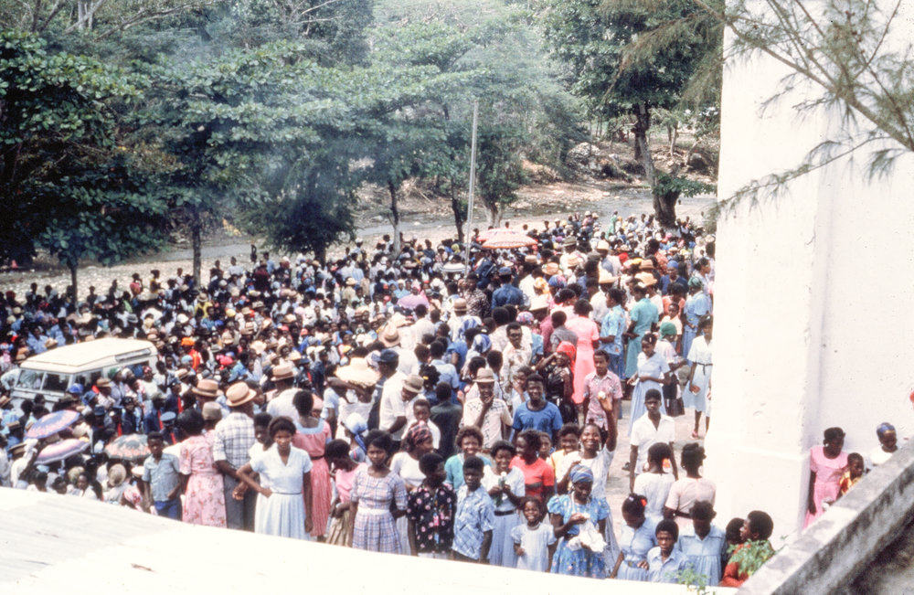Haitians outside of church.