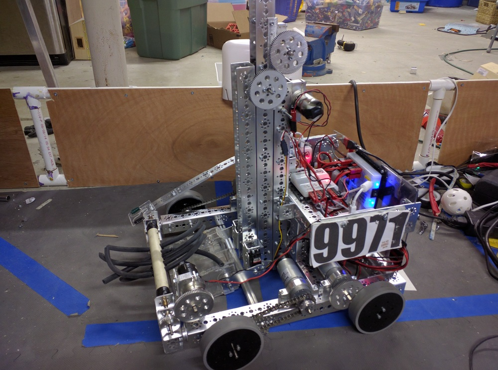 "This robot was designed specifically for the ""Flashback to the Future"" off-season scrimmage that was on May 22nd, 2016.  We decided to call it ""Throwback"" because we had a throwback to Block Party and based it off of some of the old Block Party bots.  The reason we modeled it after old Block Party robots was because that since this was an off-season scrimmage they were using a modified RES-Q field but with elements from every past game (hence the name ""Flashback to the Future""). When we read the rules for the modified game, we saw that scoring cubes into the Block Party pendulums was the most efficient and effective way to score points. Because of that we decided that it would be a fun off-season project would be to create a whole new robot for this scrimmage that was based on Block-Party designs."