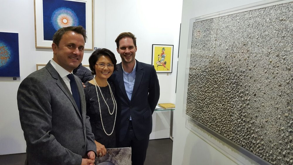Luxembourg Prime Minister Xavier Bettel and his husband at the Artskoco stand , Luxembourg Art Week 2016
