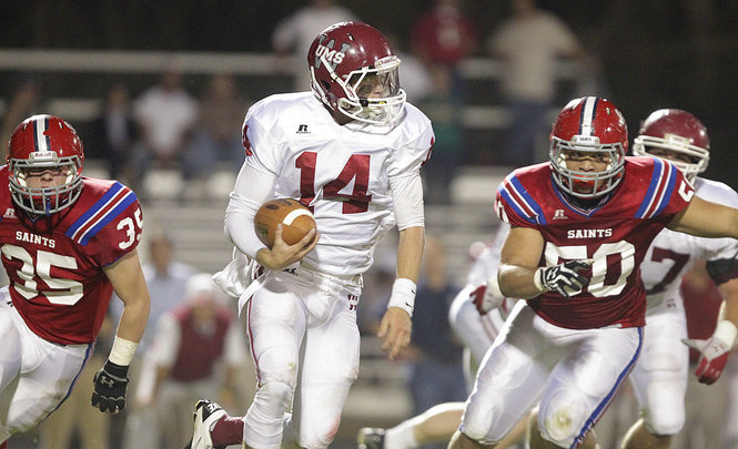 """UMS-W quarterback running from St. Pauls tacklers in the """"Battle of Old Shell Road"""""""