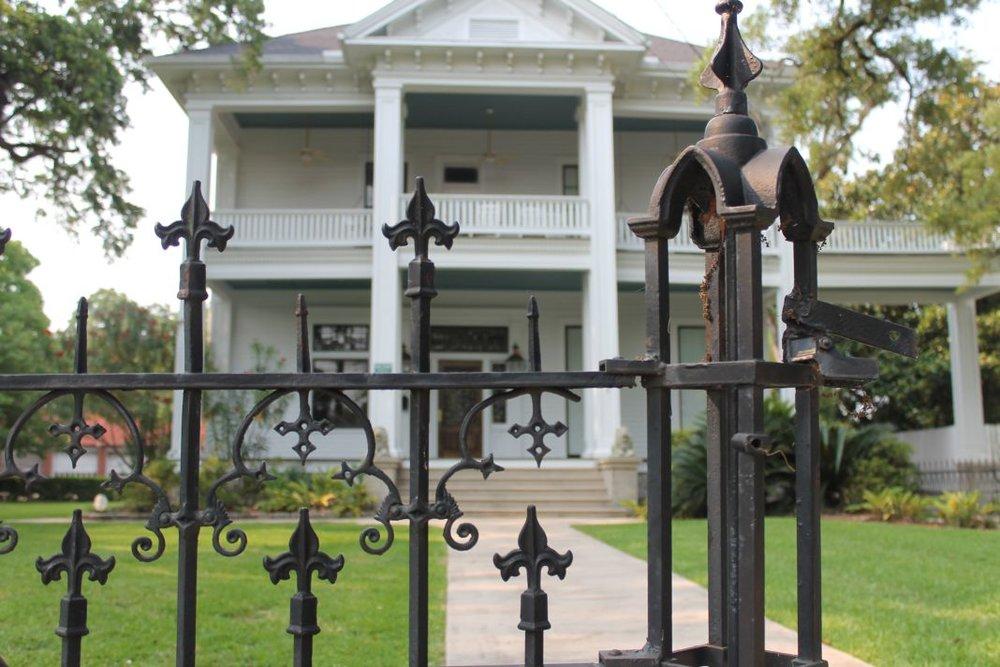 Iron-Fence-and-Home-Dauphin-Street-Mobile-Alabama-May-2012.jpg