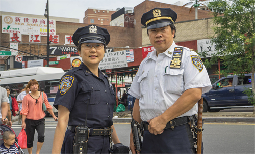 OMSC board member Timothy Chiu and his wife, May, are NYPD auxiliary officers