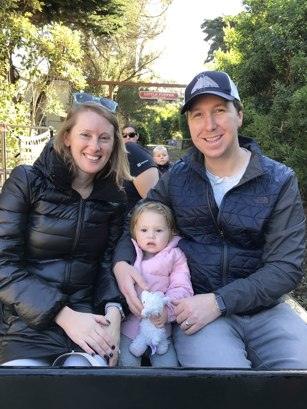 Kindergarten teacher, Julia, with her family representing MTS at the San Francisco Zoo.