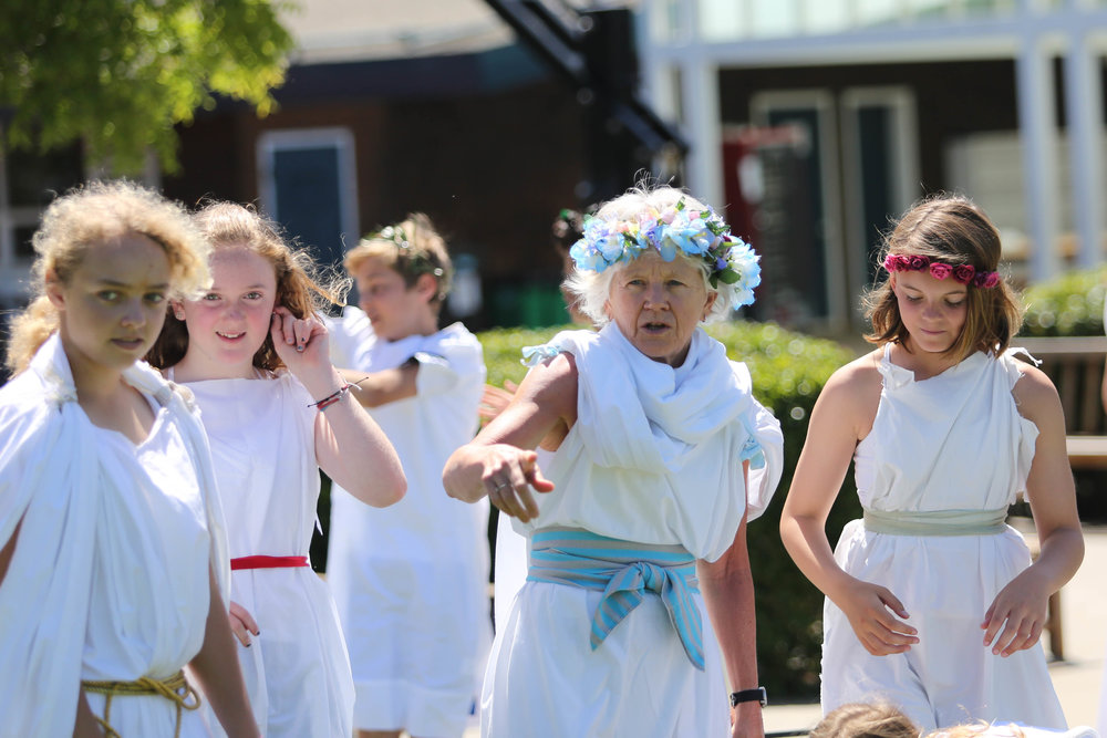 Nancy Tracy leading students in activities during Greek Day.