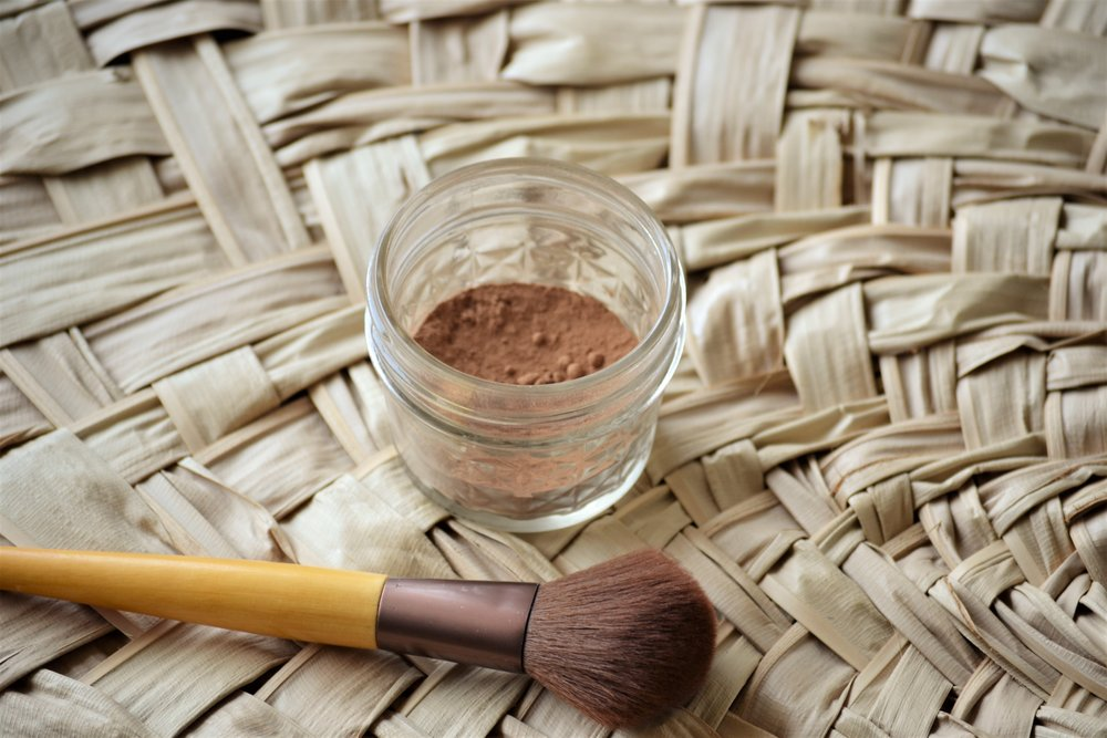 Bronzer - Place 3 TBS of cacao powder into a small mason jar or container and brush on as desired.