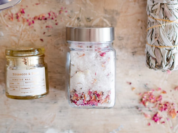 Homemade Rose & Lavender Bath Salts - Looking to create something personal but are short on time? This is the gift for you. It's super simple and inexpensive to make; all you need is a glass container, non-scented Epsom salts, several drops of some rose essential oil, dried rose petals and lavender buds. Combine all of the ingredients together and volia!
