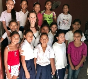 Ronnie Maher, Executive Director, NicaPhoto, Nicaragua, along with some of the girls who participated in The Community Bots program