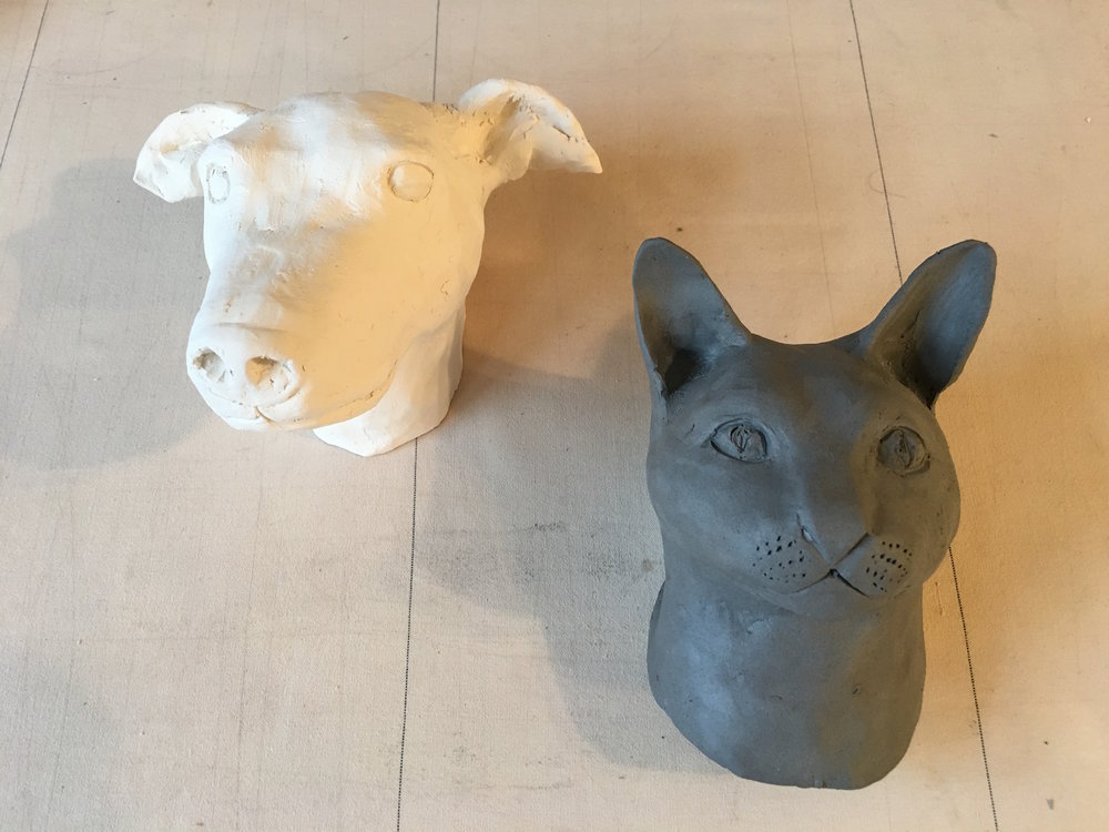 Portrait of Carmella (bisqued) and TT (wet clay)