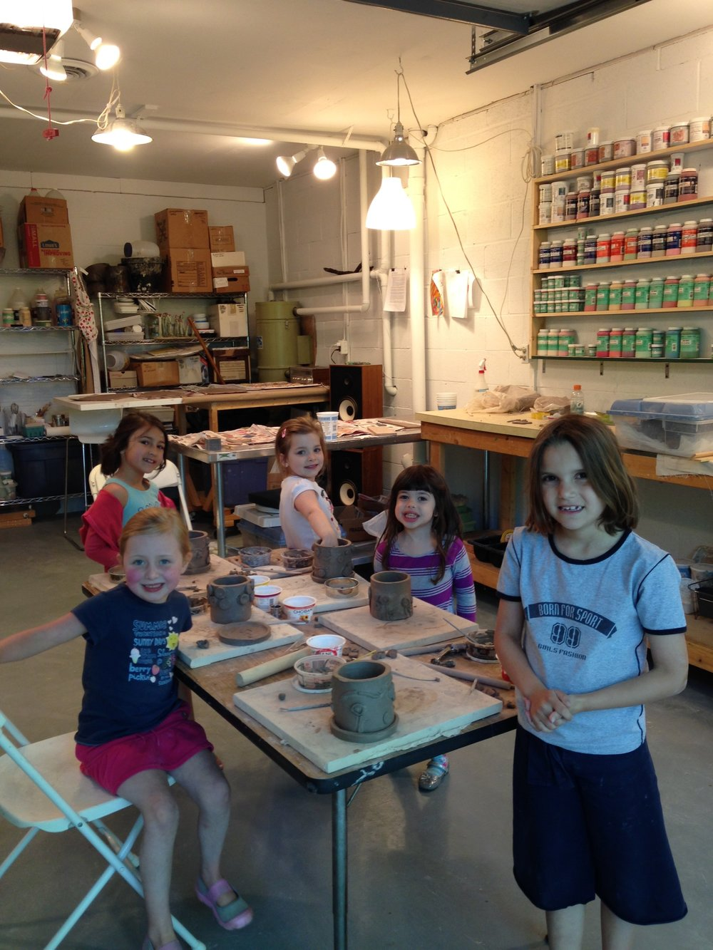 Humble beginnings. Nina with clay camp friends.