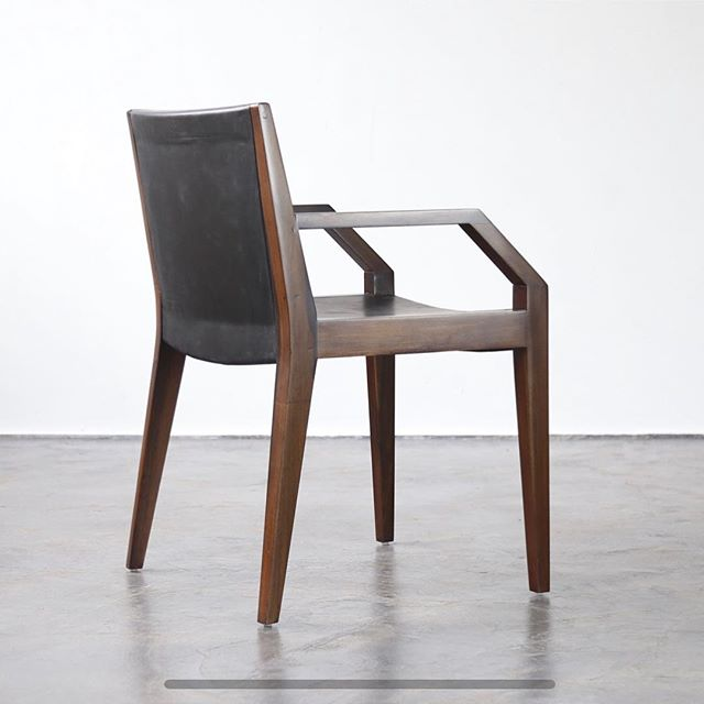 The Giovanni Armchair in Argentine Rosewood and black leather.  In stock as shown.