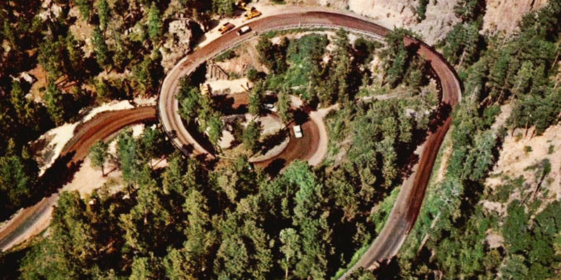 "Iron Mountain Road is known for its wooden spiral-shaped ""pigtail"" bridge"