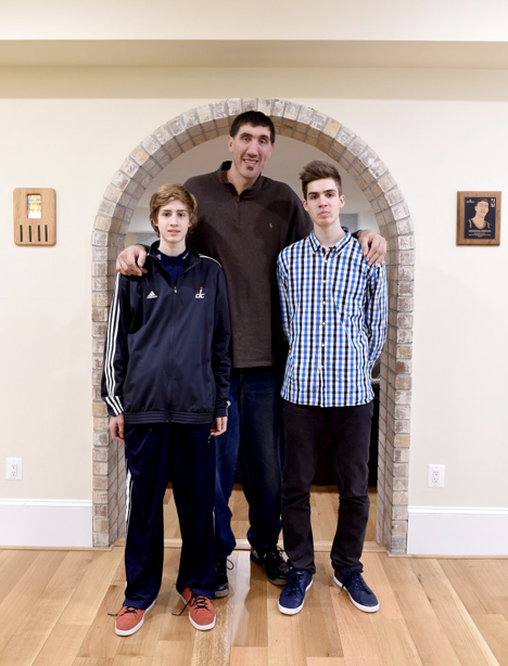 Gheorghe Muresan with his sons, Victor (left) and George (right) at their home in Potomac. (Jonathan Newton/The Washington Post)