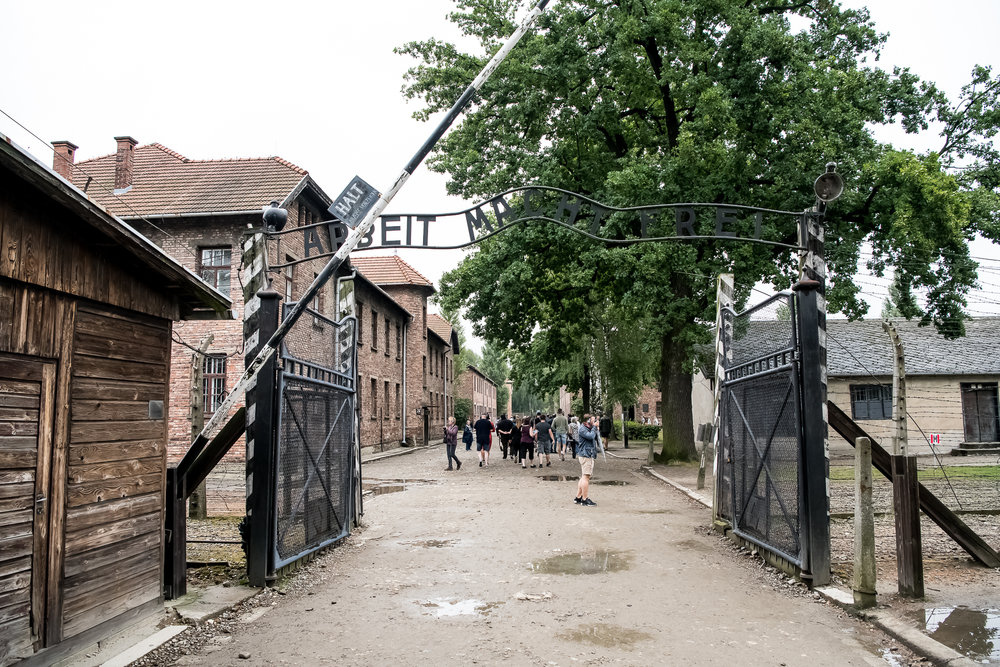 """Work sets you free"" - displayed above the entrance of Auschwitz"