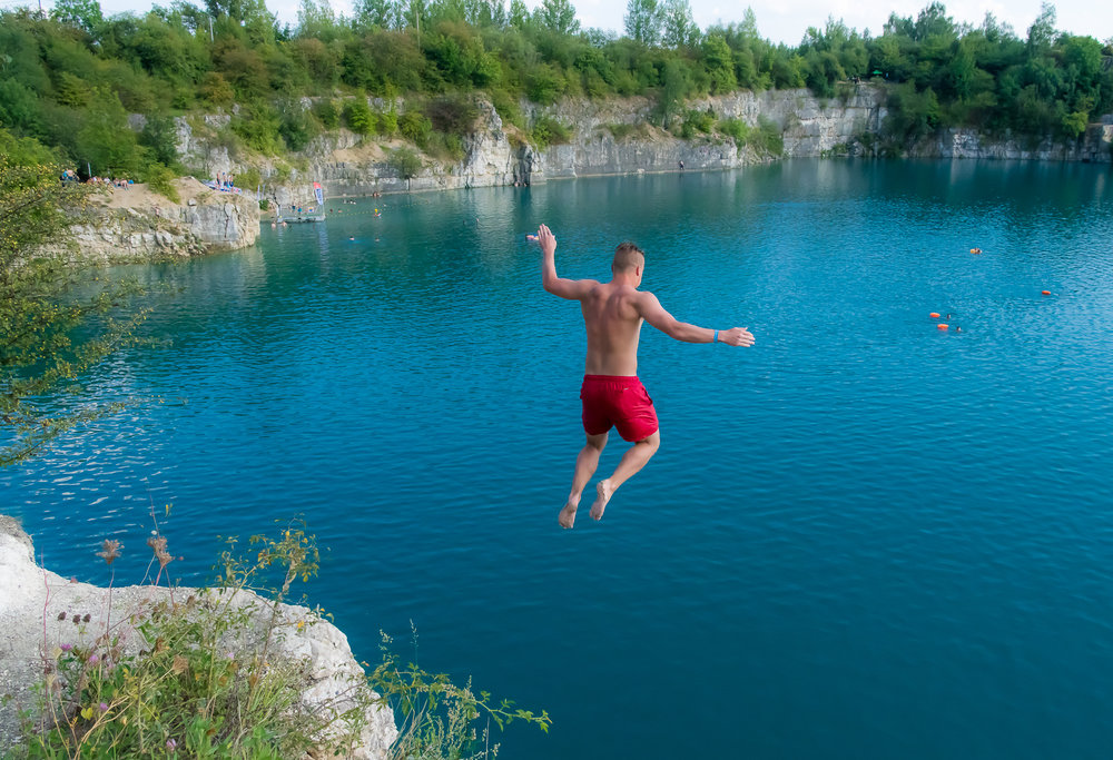 On Summer weekends, locals jump from the steep cliffs of the old quarry!