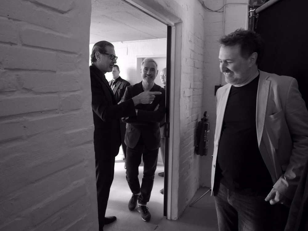 Roland, Jeff, and Harald Kloser have a laugh behind the scenes in Germany